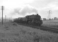 A black 5 on an eastbound oil train disturbs the golfers near Crookston in July 1962.<br><br>[Colin Miller 01/07/1962]