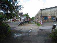 Looking north over the former level crossing at Torrington station, Devon, on 3 July 2008. The old station building is now the <I>Puffing Billy</I> public house and the area under the platform canopy has been enclosed.<br><br>[John McIntyre&nbsp;03/07/2008]