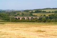 The approach to Roxburgh from the south on 1 July 2008. The impressive viaduct over the River Teviot once carried the route to Kelso and on towards the ECML. Just over 40 years earlier it had featured prominently in <I>The Great Escape (Kelso version)</I> [see image 17963]. <br><br>[John Furnevel&nbsp;01/07/2008]