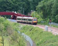 The 1018 service from Glasgow Queen Street seen on 12 June 2008 approaching the footbridge that replaced the level crossing at Alloa West.<br><br>[John Furnevel&nbsp;12/06/2008]