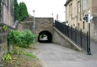 Looking north on 2 July 2008 along the route of the Alloa Wagonway running below Bedford Place towards the Drysedale Street/Mar Street underpass in the distance. To the right is the ramp up to street level, above which can be seen a statue of St Margaret standing over the Alloa War Memorial in its walled garden of remembrance on Bank Street. The memorial was unveiled by Field Marshall Earl Haig himself in 1924. <br><br>[John Furnevel&nbsp;02/07/2008]