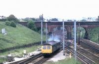 A Cravens 105 twin power car DMU to Colne leaves the slow lines south of Preston to climb up the Farington Curve. This view from Flag Lane is unchanged today (apart from the stock) and Bee Lane bridge in the picture is still an excellent vantage point. <br><br>[Mark Bartlett&nbsp;12/06/1981]