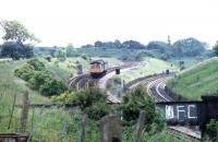 Having just crossed over the WCML (off picture to the left), a Cravens 105 DMU drops down the 1908 built curve to join it at Farington Curve Junction with a Colne - Preston service. Coming in from the right is the line from Liverpool / Ormskirk. The scene is little changed since the photograph was taken in June 1981 apart from the DMU itself and the Liverpool / Ormskirk line, which has since been singled.<br><br>[Mark Bartlett&nbsp;12/06/1981]