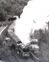 The last steam locomotive to be built by British Railways in 1960, class 9F 2-10-0 92220 <I>Evening Star</I>, pictured leaving Grosmont (and how) in 1986 while operating on the North York Moors Railway. <br><br>[Colin Miller&nbsp;//1986]