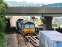DRS 66419 crosses to the westbound line out of Grangemouth at Fouldubs Junction on 2 July with containers for Aberdeen. A second locomotive can be seen waiting for the road with a train in the W H Malcolm depot in the background beyond the M9 Motorway flyover.<br><br>[John Furnevel&nbsp;02/07/2008]