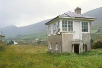 Abandoned signal box at Kells, County Kerry, in 1981. The 1893 station at Kells, on the Great Southern and Western Railway Valencia Harbour branch, closed in 1960. This 40 mile branch off the Tralee - Mallow main line reached the most westerly location in Europe to be served by rail. [Valencia Island was also the point at which the first transatlantic telegraph cable came ashore in 1858].<br><br>[Bill Roberton&nbsp;//1981]