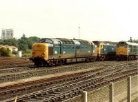 Lineup at York MPD on 2 September 1981 includes Deltic 55018 <I>Ballymoss</I>, 47480 and 31319. One of the towers of York Minster can be seen on the far left of the picture.<br><br>[Colin Alexander&nbsp;02/09/1981]