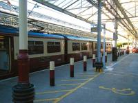 Saturday evening at Helensburgh Central on 14 June, with the glass platform canopies letting in the evening sunshine. View out along platform 1, occupied by the recently arrived 320312.<br><br>[Veronica Inglis&nbsp;14/06/2008]