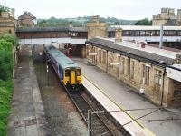 Platform 5 at Lancaster Castle is a through road alongside the up line but most services, like 156470 here, arrive from and then depart to the north either for Morecambe or, as in this case, Barrow-in-Furness. View south towards Preston.<br><br>[Mark Bartlett&nbsp;14/07/2008]