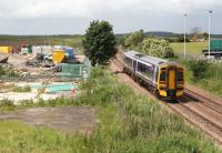 A 158 heads north towards the Forth Bridge on 26 June past a compound associated with the nearby tramworks. This site has been proposed as the location for the Edinburgh Airport tram-train interchange (to be called Edinburgh Gateway).<br><br>[John Furnevel&nbsp;26/06/2008]