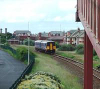 Approaching Blackpool Pleasure Beach from Squires Gate is 150207 on a service from Colne. This is the last station before the terminus at Blackpool South.<br><br>[Mark Bartlett&nbsp;12/06/2008]
