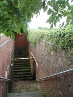 Bay Horse is a very rural location and the still open subway under the line is an unusual survivor. This is the up side showing the subway entrance and also the former access to the up platform, now bricked up. <br><br>[Mark Bartlett 14/07/2008]
