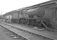 Class 2P 4-4-0 40615 stands on the scrap road at Corkerhill shed in July 1962.<br><br>[Colin Miller&nbsp;11/07/1962]