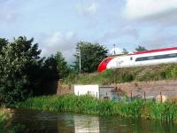 A Pendolino speeds north through Garstang and Catterall. The retaining wall by the Lancaster Canal once supported the Garstang and Knott End Railway track alongside the main line. <br><br>[Mark Bartlett&nbsp;21/07/2008]