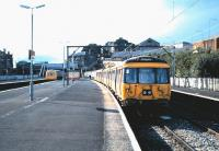 A DMU has just arrived at Springburn platform 2 from Cumbernauld in September 1985 as 303 032 waits in the bay with a Milngavie train.  <br><br>[David Panton&nbsp;/09/1985]