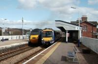 Passing services at Stonehaven on 2 April 2008, with an Aberdeen bound HST alongside 170 428 on a service to Edinburgh.<br><br>[David Panton&nbsp;02/04/2008]