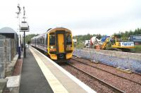 Work on the new platform and related infrastructure underway on the north side of the station at Uphall on 25 July 2008 as an eastbound 158 service arrives.<br><br>[John Furnevel&nbsp;25/07/2008]
