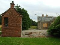 A siding ran between the two buildings. The smaller one on the left appears in many photographs and seems to be a gate keepers office for the distillery.<br><br>[John Gray&nbsp;26/07/2008]