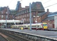 Looking across the platforms at Ayr station in July 2002. The station Hotel dominates the background.<br><br>[John Furnevel&nbsp;12/07/2002]