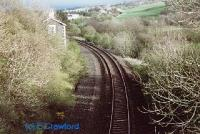 Looking south at Pinwherry. The loop line (new looking ballast to left) was lifted in the 1980s. The building was the station building.<br><br>[Ewan Crawford&nbsp;//]