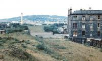 Looking north towards Corstorphine Hill circa 1972 with the site of Dalry Middle Junction on the other side of the gap left by the former railway bridge across Dalry Road. The diverging trackbeds of the old Caledonian routes to Haymarket West Junction (left) and Coltbridge Junction (right) can be clearly seen.<br><br>[John Furnevel&nbsp;//1972]
