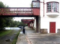The former Crieff branch platform and disused section of footbridge at Gleneagles in September 2004. View north with the operational platforms and footbridge off to the right [see image 1621].<br><br>[John Furnevel&nbsp;11/09/2004]