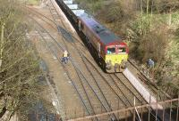 Southbound coal empties on the Edinburgh sub at Craiglockhart Junction behind EWS 66103 about to pass under the Union Canal in March 2002. The line to the left leads to Slateford Junction.<br><br>[John Furnevel&nbsp;03/03/2002]