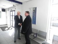 Alistair Findlay is congratulated by Councillor John McGinty following the unveiling at Bathgate station on 24 March 2011 [see news item]. <br><br>[First ScotRail&nbsp;24/03/2011]