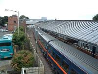GNER train stops in southbound platform. Connection bus waits.<br><br>[Ewan Crawford&nbsp;//]