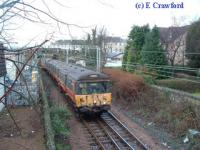 Last Blue Train heads east just east of Helensburgh Central.<br><br>[Ewan Crawford&nbsp;30/12/2002]