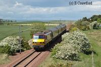 Locomotive hauled train passing Dirleton and heading south. The sea is in the distance.<br><br>[Ewan Crawford&nbsp;//]