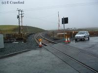 Woodend Level Crossing looking west after re-instatement of the track but before opening.<br><br>[Ewan Crawford&nbsp;//]