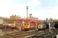 The hive of activity that was <I>'Kings Cross Loco'</I>, the stabling and fuelling point squeezed into the area between the end of the platforms and Gasworks Tunnel. The location is seen here on 6 August 1968 with (Left to Right) Brush Type 4s D1531, D1542 and D1556 amongst those making use of the facilities that day.<br><br>[John Furnevel&nbsp;06/08/1968]