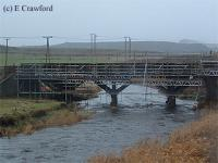 Looking north at the partly re-built wooden trestle bridge at Fordmouth. A new concrete deck was added.<br><br>[Ewan Crawford&nbsp;//]