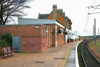 Platform view south at Dunbar station in December 2004. The single platform is located alongside a loop on the up side of the East Coast Main Line.<br><br>[John Furnevel&nbsp;19/12/2004]