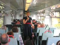 Ishbel McFarlane entertaining passengers on one of the First ScotRail Edinburgh - Glasgow via Shotts services as part of The Arches 'On the Verge' festival. <br><br>[First ScotRail&nbsp;24/06/2010]