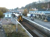 A chilly Dingwall station looking south on a November morning in 2003. The area beyond the abandoned platform (left) on the east side of the station is in danger of becoming a rubbish dump.<br><br>[John Furnevel&nbsp;23/11/2003]