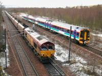 Scene at the north end of Millerhill yard on 22 March 2005. A train of coal empties has just received a green light and is heading for Niddrie West Junction and the 'sub'. The cause of the holdup, a terminated Bathgate - Newcraighall DMU, has just run into the turnback siding. The 4-car train will form the next service to Dunblane.<br><br>[John Furnevel&nbsp;22/03/2005]