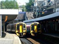 Scotlands busiest mainline platforms? Haymarket station platforms 3 and 4 in May 2004, with ScotRail 158s standing side by side in the sunshine.<br><br>[John Furnevel&nbsp;17/05/2004]
