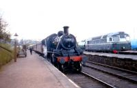 Platform scene at Boat of Garten in May 2002. Ivatt 2-6-0 46512 is waiting to depart with a train for Aviemore, while BRCW Type 2 D5325 stands over on the right [see image 5540].<br><br>[John Furnevel&nbsp;14/05/2002]