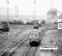 Looking south over Millerhill down yard in April 1980, with Monktonhall Colliery coal loading facility in the right background.<br><br>[John Furnevel&nbsp;22/04/1980]