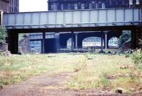 Looking west towards Princes Street in May 1970 along the former Caley trackbed with Grove Street bridge nearest the camera and the tenements of Gardner's Crescent beyond. The lines to the left ran into Princes Street station and to the right Lothian Road goods. The route was later to become Edinburgh's Western Approach Road.<br><br>[John Furnevel&nbsp;26/05/1970]