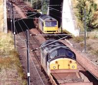 North end of Millerhill in September 1997, with 37108 on a departing PW train about to pass 60058 with the returning Lackenby steel flats.<br><br>[John Furnevel&nbsp;16/09/1997]
