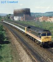 Class 47 hauled passenger train passing south past the site of Stirling MPD.<br><br>[Ewan Crawford&nbsp;//]