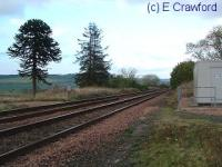 Looking north at Dunning. The signalbox was located to the left by the monkey puzzle tree.<br><br>[Ewan Crawford&nbsp;//]