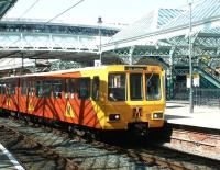 A city bound Tyne & Wear Metro service, destination St James, runs into Tynemouth station on 10 July 2004 in bright sunshine.<br><br>[John Furnevel&nbsp;10/07/2004]