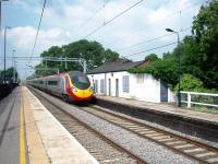 Penkridge has not got many features but this Pendolino rattles the shutters on the disused station building as it heads for Wolverhampton. See 18690 for a view by Ewan of the outside of this structure. <br><br>[Mark Bartlett&nbsp;27/07/2008]