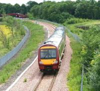Morning train from Glasgow approaching Alloa West footbridge in June 2008.<br><br>[John Furnevel&nbsp;12/6/2008]