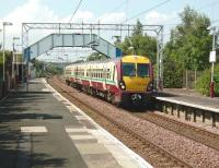 A Gourock - Glasgow Central service formed by 334 040 makes a stop at Paisley St James on 28 July. This station is to be eventually closed and a replacement built further east as part of the changes resulting from construction of the Glasgow Airport Rail Link. [See image 30523]<br><br>[David Panton&nbsp;28/07/2008]