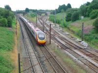 The pointwork around Farington Curve Junction can be clearly seen in this view south from Bee Lane bridge in August 2008 as a Pendolino heads north towards Preston. The Ormskirk route curves off to the far right while, in the centre, the line to Blackburn starts to climb before eventually turning east and crossing over the WCML.<br><br>[Mark Bartlett&nbsp;01/08/2008]